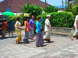 Balinese people are going visit to Tanah Lot